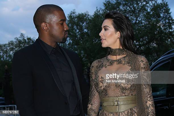 Kim Kardashian West and Kanye West attend the Vogue 100 Gala Dinner at the East Albert Lawn in Kensington Gardens on May 23 2016 in London England