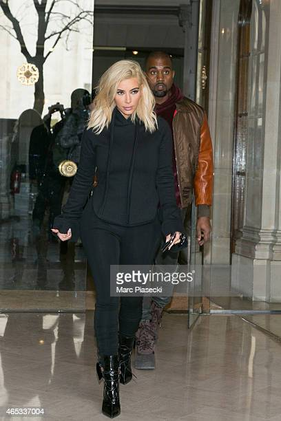 Kim Kardashian West and Kanye West leave the 'Givenchy' office on March 6 2015 in Paris France