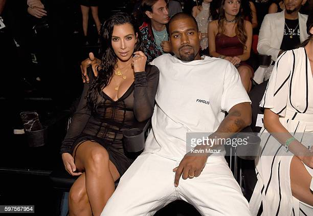 Kim Kardashian West and Kanye West sit in the audience at the 2016 MTV Video Music Awards at Madison Square Garden on August 28 2016 in New York City