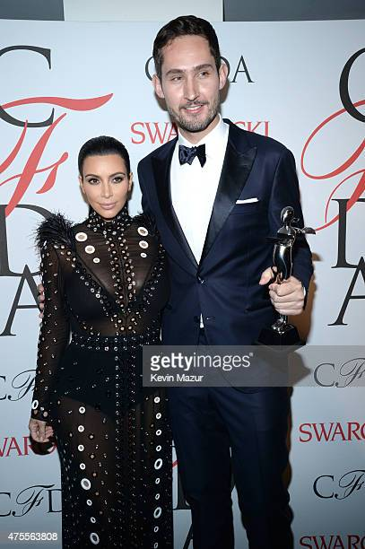 Kim Kardashian West and Kevin Systrom pose backstage at the 2015 CFDA Fashion Awards at Alice Tully Hall at Lincoln Center on June 1 2015 in New York...
