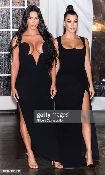 Kim Kardashian West and Kourtney Kardashian are seen arriving to the amfAR New York Gala 2019 at Cipriani Wall Street on February 6 2019 in New York...