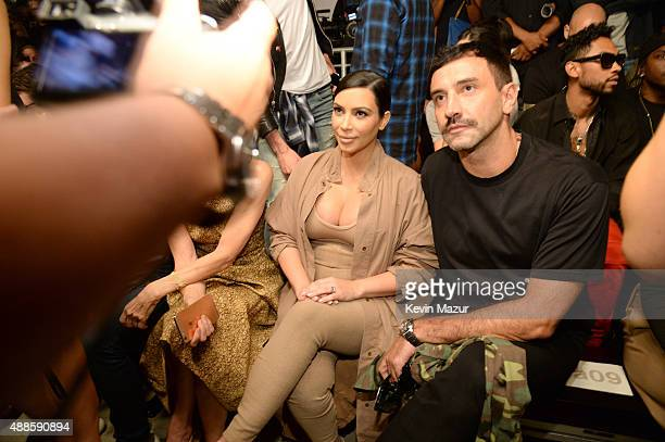 Kim Kardashian West and Riccardo Tisci attend Kanye West Yeezy Season 2 during New York Fashion Week at Skylight Modern on September 16 2015 in New...