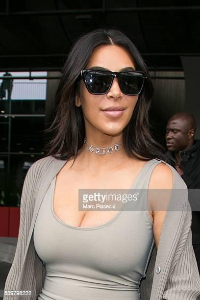 Kim Kardashian West arrives at ChrledeGaulle airport on June 13 2016 in Paris France