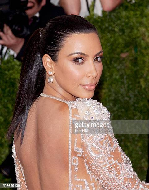 Kim Kardashian West attends 'China Through the Looking Glass' 2015 Costume Institute Benefit Gala red carpet arrivals at the Metropolitan Museum of...