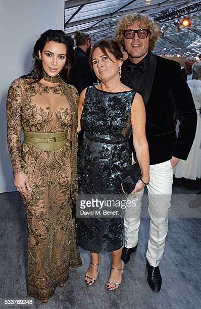 Kim Kardashian West British Vogue editor Alexandra Shulman and Peter Dundas attend British Vogue's Centenary gala dinner at Kensington Gardens on May...