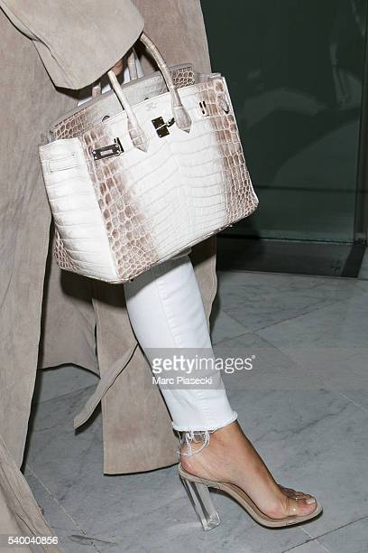 Kim Kardashian West handbag and shoe detail arrives at CharlesdeGaulle airport on June 14 2016 in Paris France