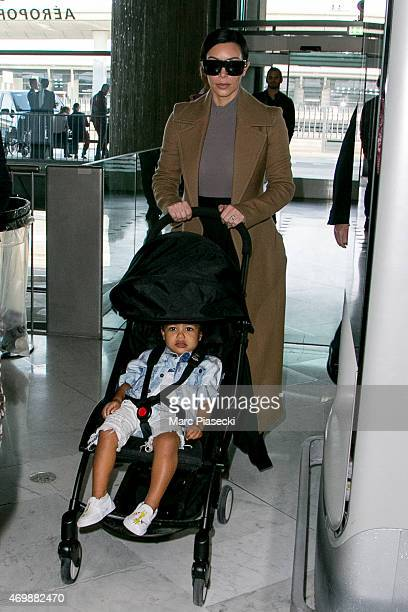 Kim Kardashian West her husband Kanye West and her daughter North west are seen at CharlesdeGaulle airport on April 16 2015 in Paris France