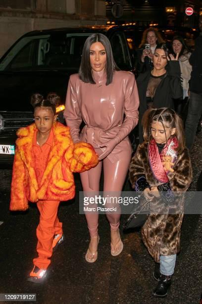 Kim Kardashian West, North West, Penelope Disick and Kourtney Kardashian arrive at FERDI restaurant on March 01, 2020 in Paris, France.