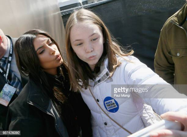 Kim Kardashian West poses with an attendee at March For Our Lives on March 24 2018 in Washington DC