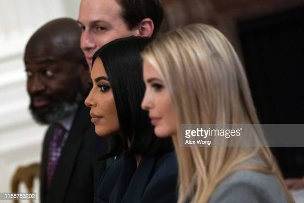 """Kim Kardashian West sits with Ivanka Trump and Jared Kushner during an East Room event on """"second chance hiring"""" June 13 2019 at the White House in..."""