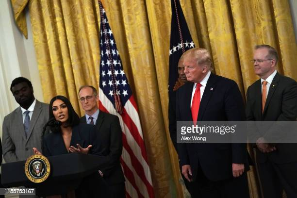 """Kim Kardashian West speaks as US President Donald Trump listens during an East Room event on """"second chance hiring"""" June 13 2019 at the White House..."""