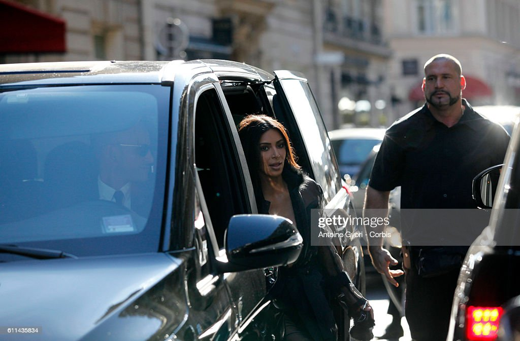 Kim Kardashian West with bodyguard Pascal Duvier (R)is sighted during Paris Fashion Week on September 28, 2016 in Paris, France.