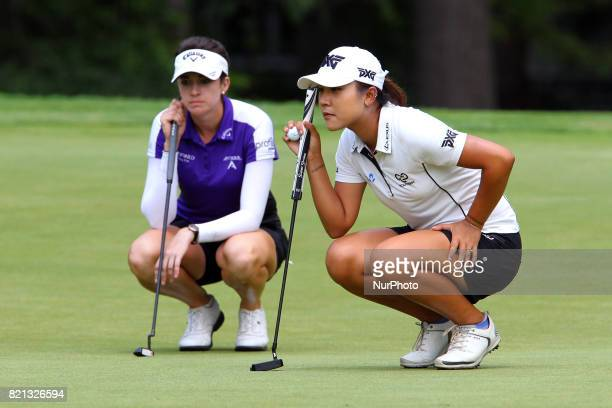 Kim Kaufman of Clark South Dakota and Lydia Ko of New Zealand line up their putts on the 14th green during the final round of the Marathon LPGA...