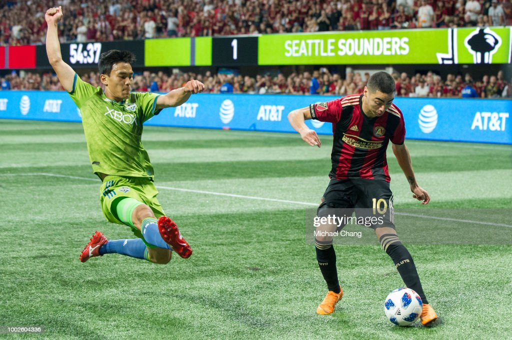 Kim Kee-Hee #20 of Seattle Sounders FC 2 looks to steal the ball from Miguel Almiron #10 of Atlanta United during the game at Mercedes-Benz Stadium on July 15, 2018 in Atlanta, Georgia.
