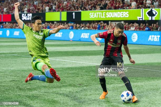 Kim KeeHee of Seattle Sounders FC 2 looks to steal the ball from Miguel Almiron of Atlanta United during the game at MercedesBenz Stadium on July 15...