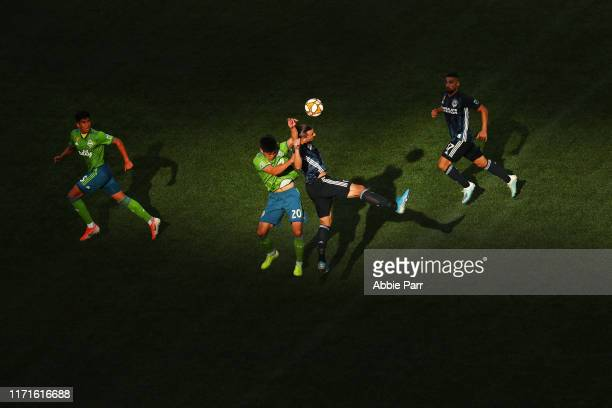 Kim KeeHee of the Seattle Sounders and Zlatan Ibrahimovic of the Los Angeles Galaxy jump for the ball in the second half during their game at...