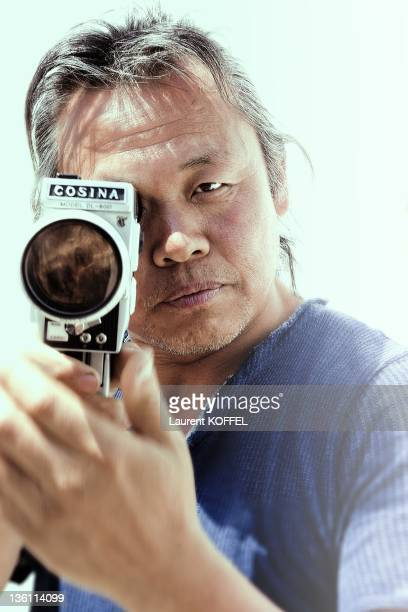 Kim KiDuk portrait session Director of the 'Arirang' film he obtains the award 'Un Certain Regard' during the 64th Annual Cannes Film Festival on May...