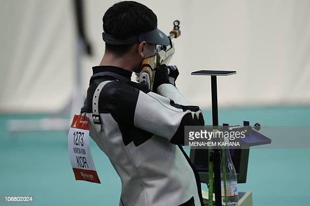 Kim Kiwon of South Korea aims his gun during the men's 10m Air Rifle shooting competition at the 16th Asian Games at the Aoti Shooting Ranges in...