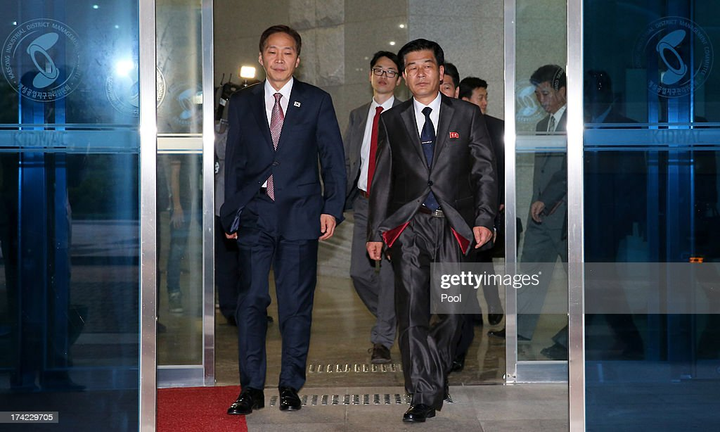 Kim Ki-Woong (L), the head of South Korea's working-level delegation leaves with his North Korean counterpart Park Chol-Su (R) after their meeting at Kaesong Industrial District Management Committee on July 22, 2013 in Kaesong, North Korea. North and South Korea today began a fifth round of conversations on reopening the Kaesong joining industrial complex, after four other meetings failed to result in an agreement. North Korea withdrew over 50,000 of its staff from the factories owned by Seoul in April of this year, and South Korea removed managers in May, during the height of tensions between the two nations.