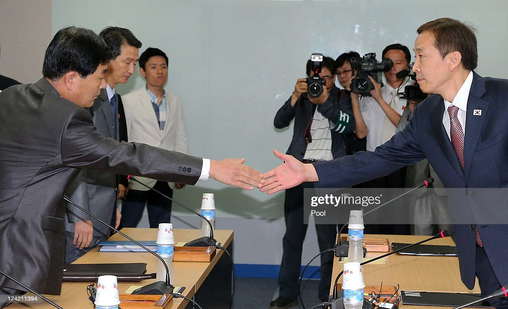 Kim Ki-Woong (R), the head of South Korea's working-level delegation shakes hands with his North Korean counterpart Park Chol-Su (L) during their meeting at Kaesong Industrial District Management Committee on July 22, 2013 in Kaesong, North Korea. North and South Korea today began a fifth round of conversations on reopening the Kaesong joining industrial complex, after four other meetings failed to result in an agreement. North Korea withdrew over 50,000 of its staff from the factories owned by Seoul in April of this year, and South Korea removed managers in May, during the height of tensions between the two nations.
