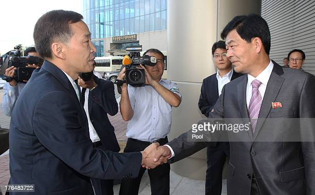 Kim KiWoong the head of South Korea's workinglevel delegation shakes hands with his North Korean counterpart Park CholSu during their meeting at...