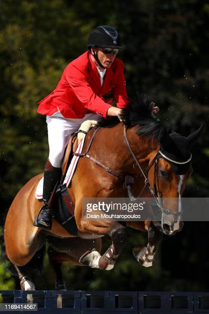 Kim Kristensen of Denmark riding Albert K competes during Day 3 of the Longines FEI Jumping European Championship speed competition against the clock...