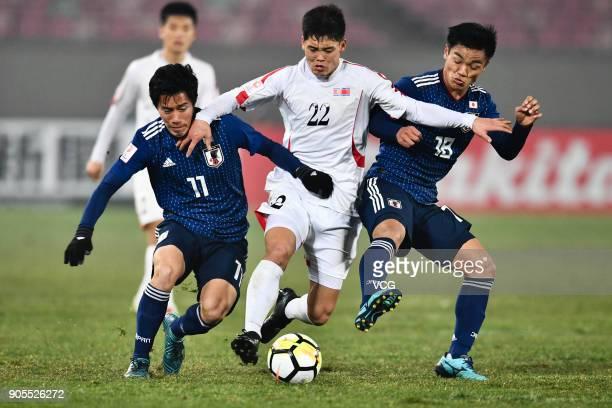 Kim Kuk-Bom of North Korea controls the ball during the AFC U-23 Championship Group B match between Japan and North Korea at Jiangyin Stadium on...