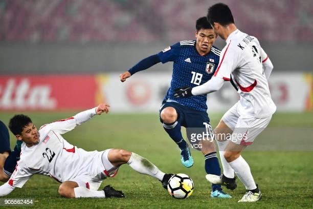 Kim KukBom of North Korea kicks the ball during the AFC U23 Championship Group B match between Japan and North Korea at Jiangyin Stadium on January...