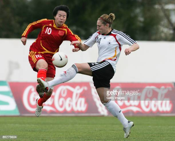 Kim Kulig and Liu Sa battle for the ball during the Women Algarve Cup match between Germany and China at the Municipal stadium on March 6 2009 in...