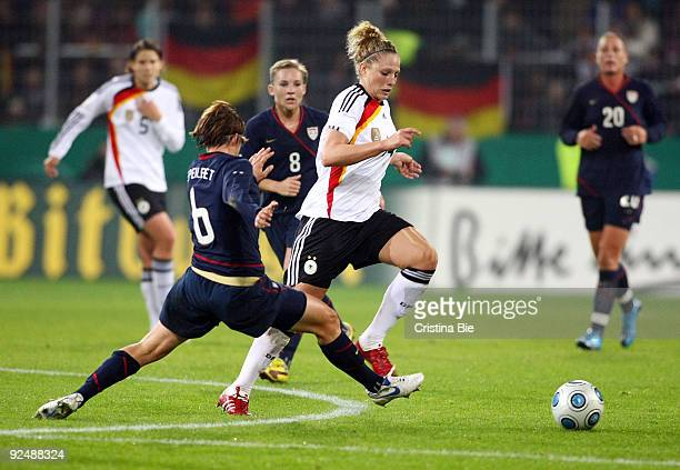 Kim Kulig of Germany and Amy LePeilet of USA battle for the ball during the Women's International friendly match between Germany and USA at the...