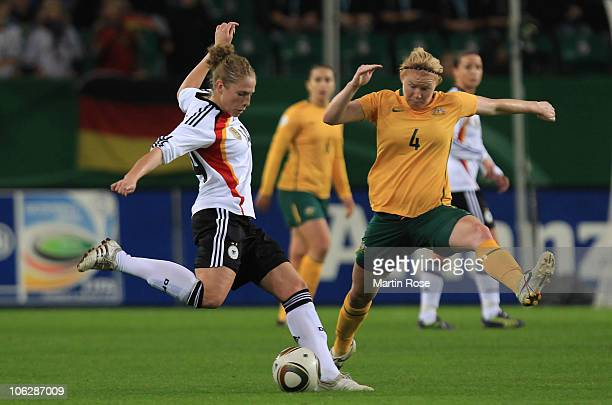 Kim Kulig of Germany and Clare Polkinghorne of Australia battle for the ball during the women's international friendly match between Germnay and...