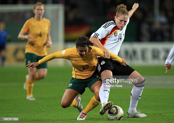 Kim Kulig of Germany and Samantha Kerr of Australia battle for the ball during the women's international friendly match between Germnay and Australia...
