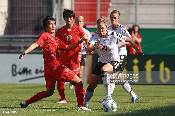 Kim Kulig of Germany battles for the ball with Myong Hwa Jon of DPR Korea during the International friendly match between Germany and DPR Korea at...