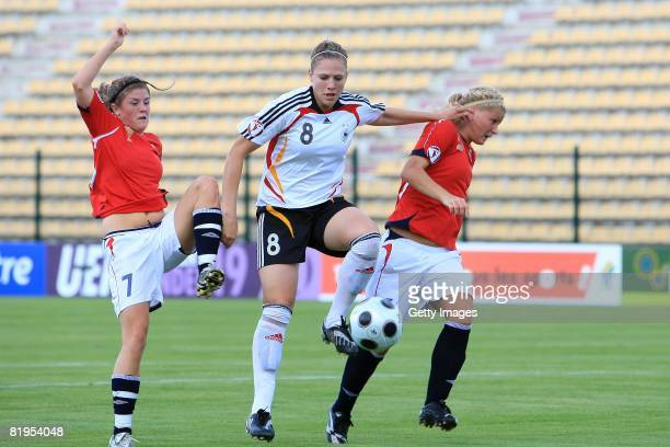 Kim Kulig of Germany between Maren Mjelde and Gunhild Herregarden of Norway during the Women's U19 European Championship match between Germany and...