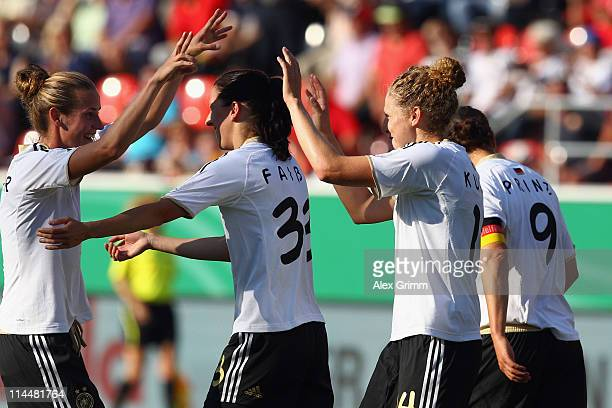 Kim Kulig of Germany celebrates her team's first goal with team mates Simone Laudehr Verena Faisst and Birgit Prinz during the International friendly...