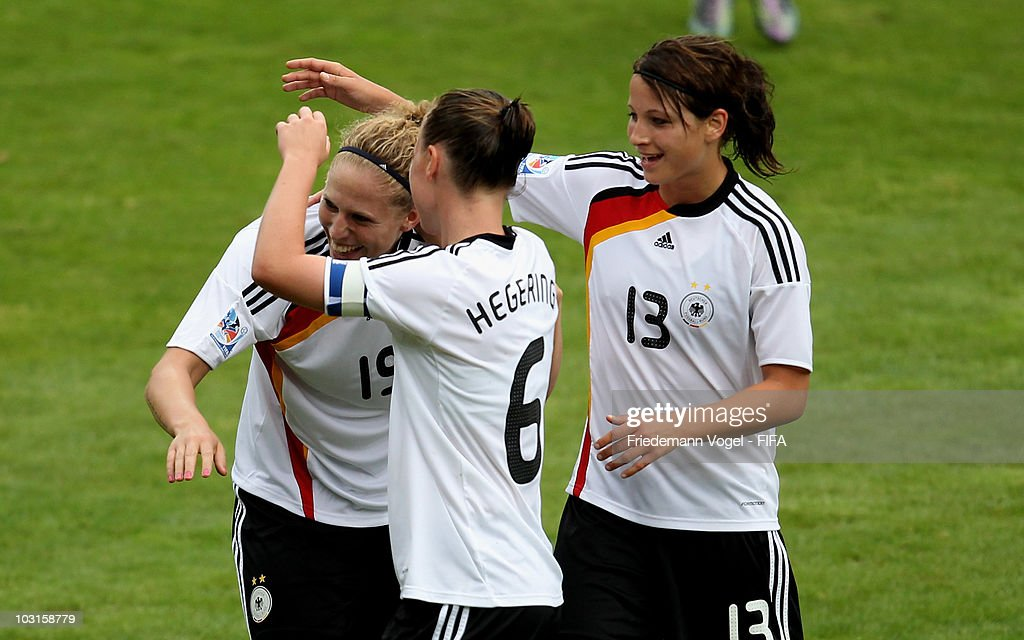 Kim Kulig (L) of Germany celebrates scoring the fourth goal with Marina Hegering (C) and Sylvia Arnold (R) during the FIFA U20 Women's World Cup Semi Final match between Germany and South Korea at the FIFA U-20 Women's World Cup stadium on July 29, 2010 in Bochum, Germany.