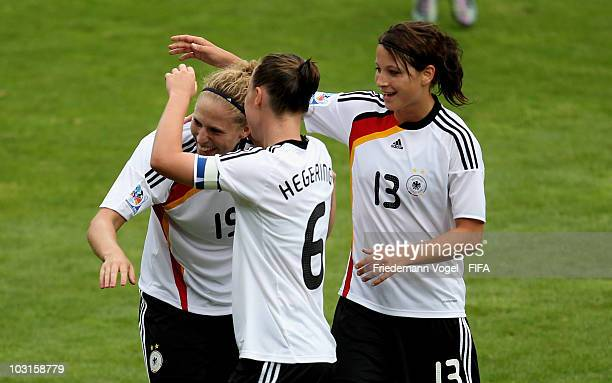 Kim Kulig of Germany celebrates scoring the fourth goal with Marina Hegering and Sylvia Arnold during the FIFA U20 Women's World Cup Semi Final match...