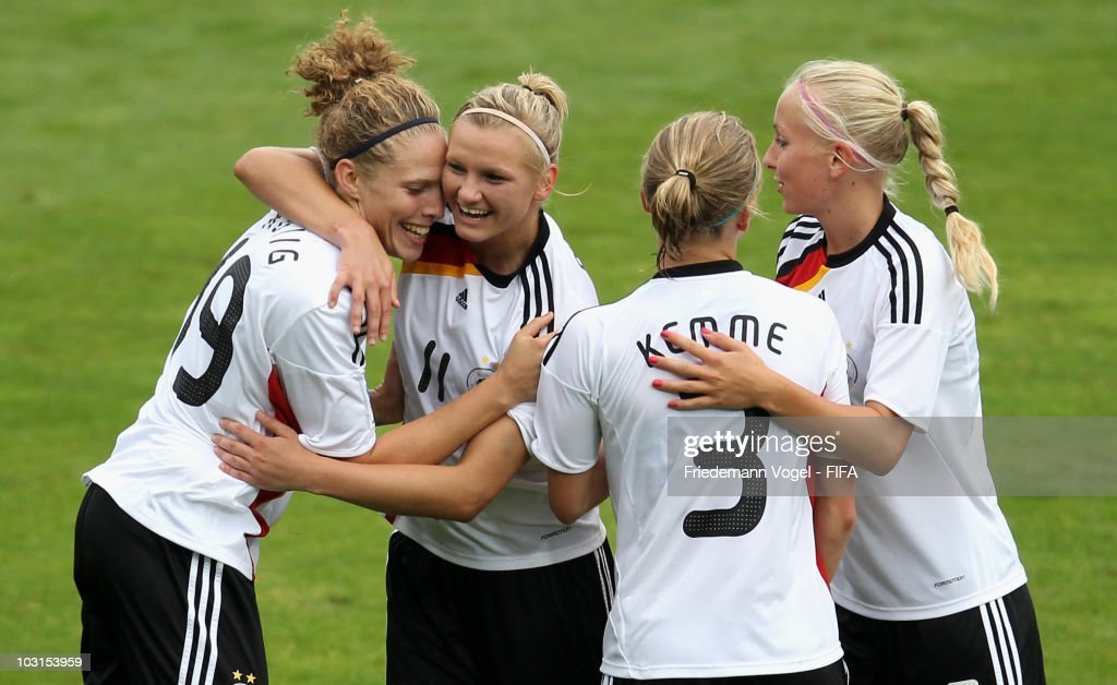 Kim Kulig (L) of Germany celebrates scoring the fourth goal with Alexandra Popp (2ndL), Tabea Kemme (2ndR) and Kristina Gessat (R) during the FIFA U20 Women's World Cup Semi Final match between Germany and South Korea at the FIFA U-20 Women's World Cup stadium on July 29, 2010 in Bochum, Germany.
