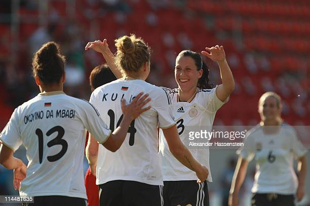 Kim Kulig of Germany celebrates scoring the opening goal with her team mates Verena Faisst and Celia Okoyino Da Mbabi during the International...