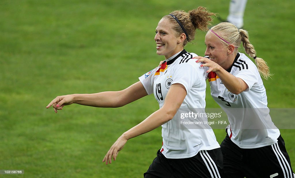 Kim Kulig (L) of Germany celebrates scoring the second goal with Tabea Kemme during the FIFA U20 Women's World Cup Semi Final match between Germany and South Korea at the FIFA U-20 Women's World Cup stadium on July 29, 2010 in Bochum, Germany.