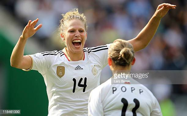 Kim Kulig of Germany celebrates with team mate Alexandra Popp who scored the third goal during the Women's International friendly match between...