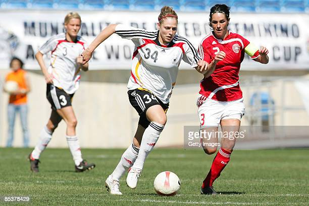 Kim Kulig of Germany fights Katrine S. Pedersen during the Woman Algarve Cup match between Germany and Denmark at the Estadio Algarve on March 11,...