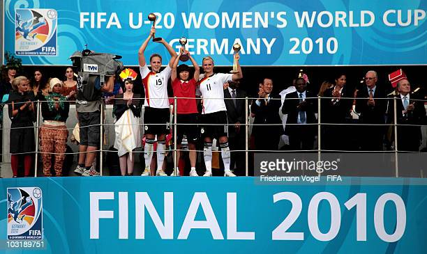Kim Kulig of Germany Ji So Yun of South Korea and Alexandra Popp of Germany celebrate after receiving the trophy as the best players during the FIFA...