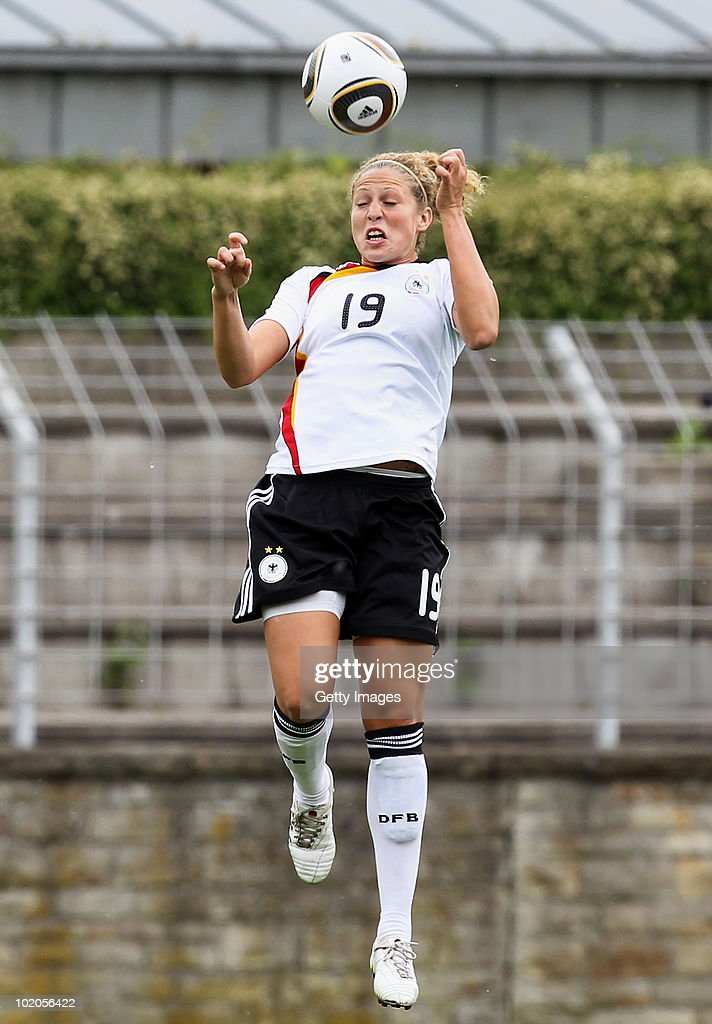 Kim Kulig of Germany jumps during the DFB women's U20 match between Germany and USA at the Ludwig-Jahn-Stadion on June 13 2010 in Herford, Gerrmany.