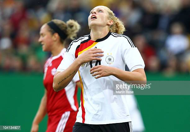 Kim Kulig of Germany reacts during the Women's International Friendly match between Germnay and Canada at Rudolf Harbig stadium on September 15, 2010...