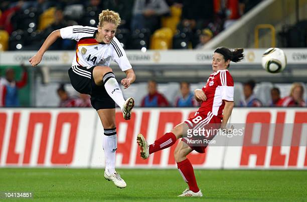 Kim Kulig of Germany runs with the ball during the Women's International Friendly match between Germnay and Canada at Rudolf Harbig stadium on...