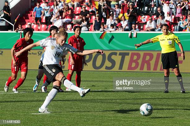 Kim Kulig of Germany scores her team's first goal with a penalty during the International friendly match between Germany and DPR Korea at Audi...