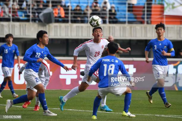 Kim Kum Song of the April 25 Sports Club of North Korea fights for the ball against players from the Gangwondo team of South Korea during their match...
