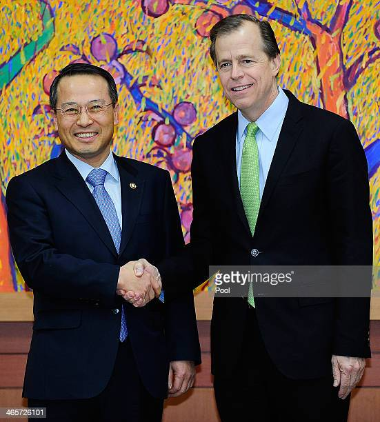 Kim KyouHyun South Korea's 1st Vice Minister of Foreign Affairs shakes hands with US Special Representative for North Korea Affairs Glyn Davies...