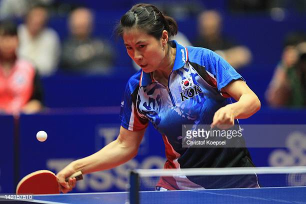 Kim Kyung Ah of South Korea plays a forehand during her matrch against Wang Yuegu of Singapore during the LIEBHERR table tennis team world cup 2012...